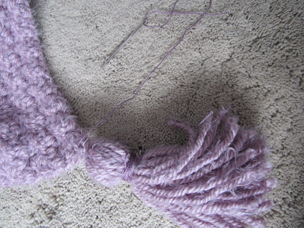 Attaching a Purple Tassel to a Blanket