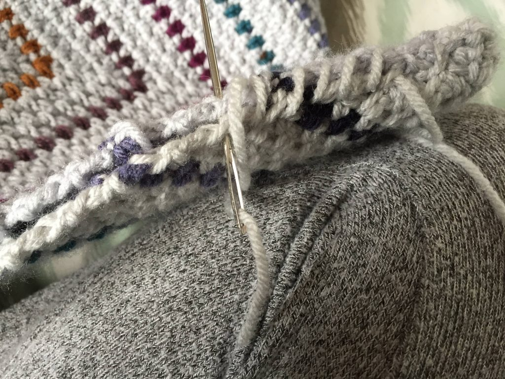 Whip Stitching the Moss Stitch Crochet Pillow Together