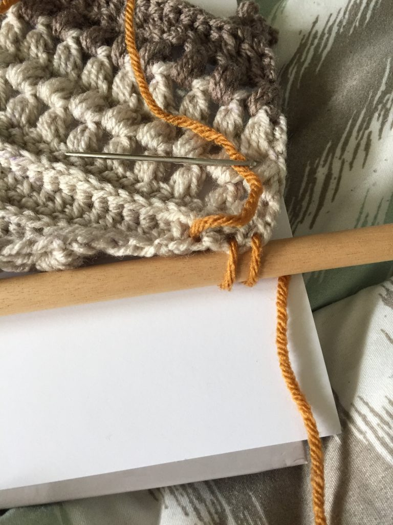 Attaching the Crochet Wall Hanging to the dowel
