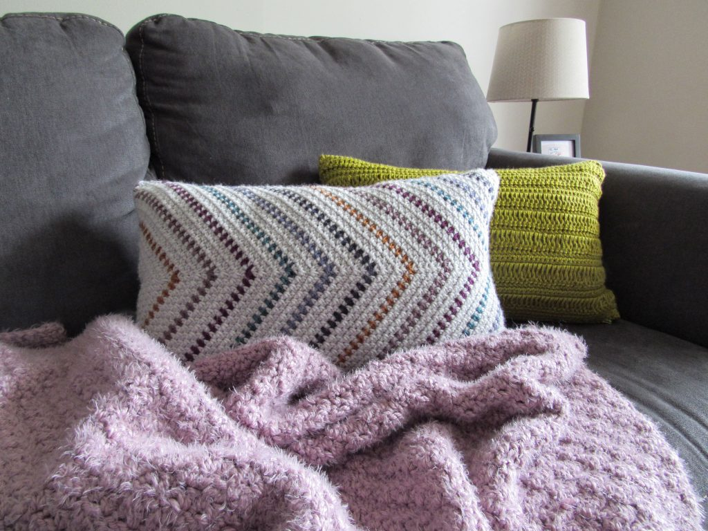 Two Crochet Pillows and a Purple Hygge Blanket