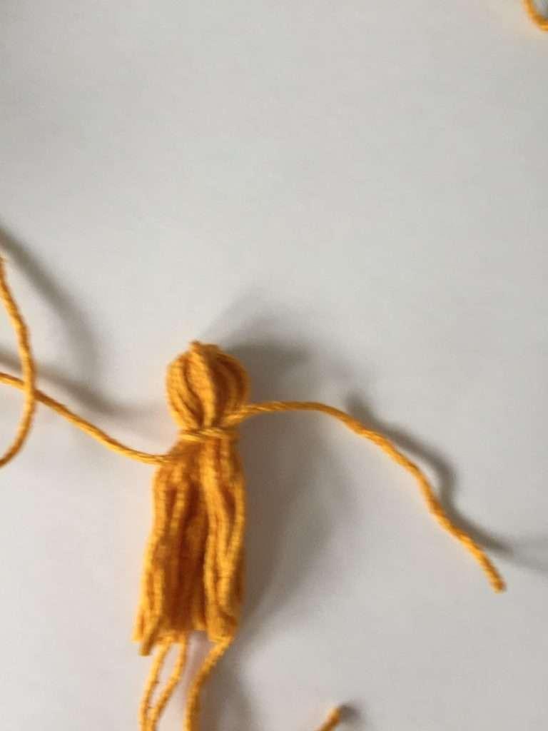 Wrap yarn to shape tassel