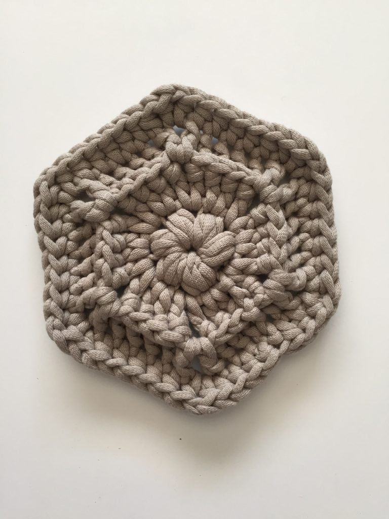 Round of Half double crochet stitches in a hexagon